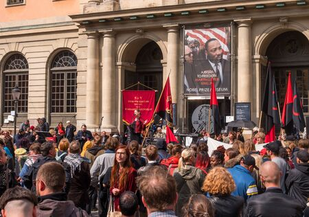 Stockholm, Sweden - May 1, 2019: First May Labor day demonstration in Stockholm. A rally on Storstorget Square at the Nobel Museum.