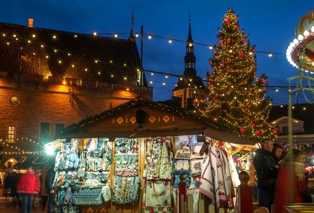 Tallinn, Estonia - January 3, 2020: Traditional christmas market in old Tallinn. Town Hall Square. A Christmas fir tree is installed on the square.