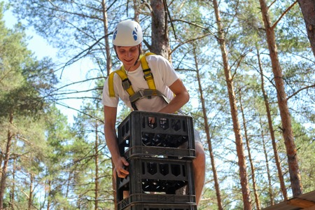 Young Man Climbs High Extreme middle