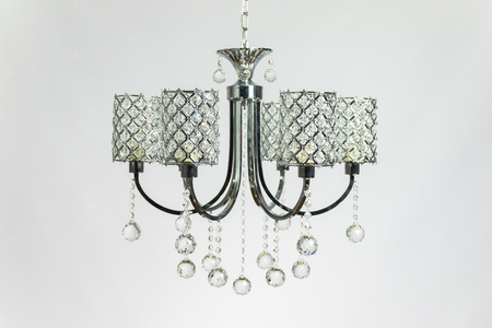 Chandelier silver gray color with crystal on the gray background Banco de Imagens