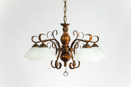 Chandelier vintage bronze with white plafonds on the gray background Banco de Imagens