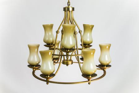 Chandelier golden color with beige plafonds