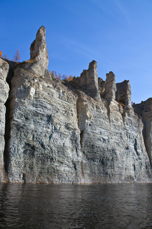 the taiga: The rocky shores of the Siberian taiga river in the fall. Moiyero river, Evenkia, Krasnoyarsk region, Russia