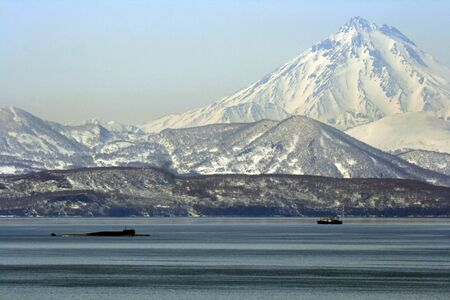 kamchatka: Avacha Bay with the submarine and fishing vessels on the background of the volcano. Kamchatka.