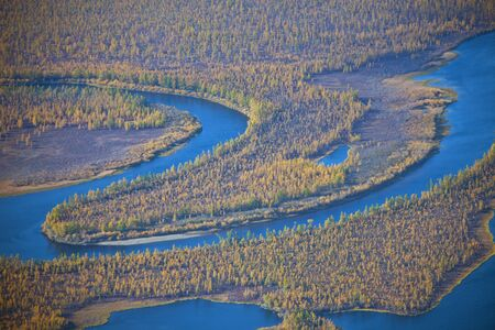 meanders: Meanders of the river  Moierokan and Siberian taiga in the fall from the helicopter. Evenkiya, Krasnoyarsk region, Russia