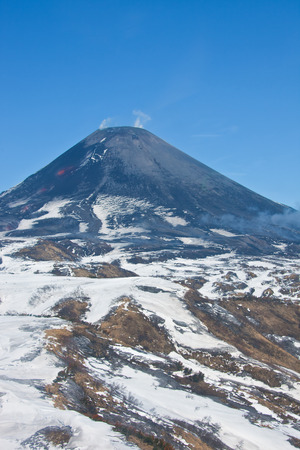 The views of the working Karymsky volcano in may 2016 with a helicopter. Kamchatka, Russia Stock Photo