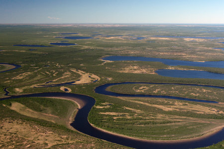 meanders: Tundra, rivers and lakes of Taimyr in the spring with the helicopter. The meanders of the river in the tundra of the Taimyr Peninsula. Siberia, Russia Stock Photo