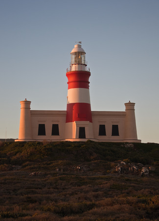 The lighthouse at Cape Agulhas at the southernmost point of Africa. Tower lighthouse in South Africa at the confluence of two oceans.