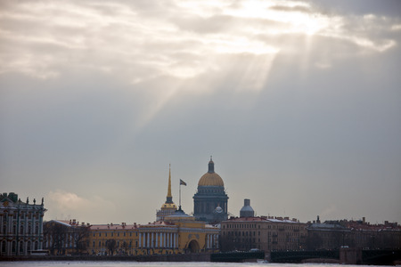 The suns rays over the historical center and the river Petersburg. The building of St. Isaacs Cathedral, the Admiralty and the Palace in the winter.