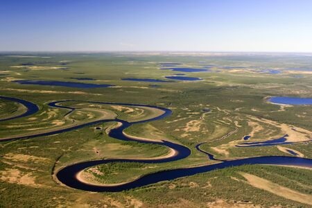 Nature of the Northern tundra of the Taimyr Peninsula view from a helicopter. Rivers, lakes and swamps in the Arctic tundra of Siberia.