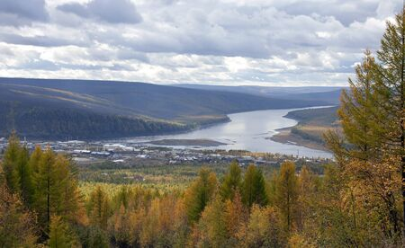 The village of Tura is the administrative center of the Evenki district in the Krasnoyarsk territory. View of the district center of the Tura in autumn. 스톡 콘텐츠 - 149690936
