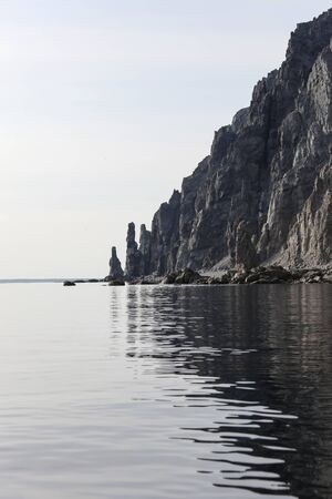 Landscape with steep cliffs of the coastline of the North-West coast of the sea of Okhotsk.