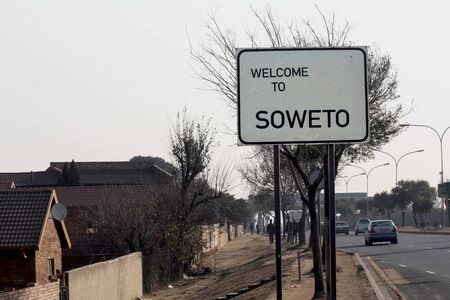 A roadside welcome banner inviting you to visit the Soweto area of JohannesburgRoad sign, road sign