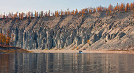 Autumn landscape on the Siberian river. Larch taiga in September on the banks of the river and in Evenkia. Krasnoyarsk region, Russia, 스톡 콘텐츠 - 151034685