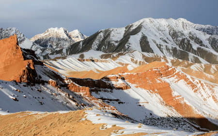 View of the mountain pass on a winter evening. Landscape of a mountain pass with rocks, stones, snow and animal tracks