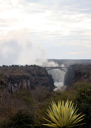 Bridge over the Zambezi river at Victoria falls. A bridge on the border of countries connecting Zimbabwe and Zambia. Africa