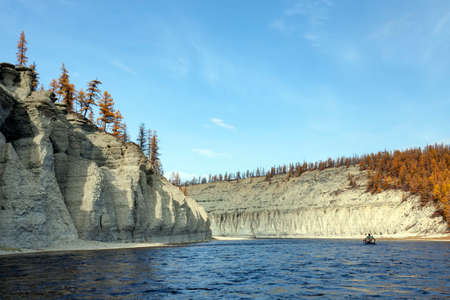 Landscape on the Siberian taiga river during rafting in September. Riverbed Moiyerocan fall during the descent from source to mouth. Evenkia, Krasnoyarsk territory, Russia, 스톡 콘텐츠 - 151149055