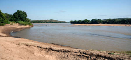 View of the landscape of the Limpopo river on the state border of South Africa and Zimbave. The surface of the water and sandy beach of the river in a clear Sunny day. Africa, 스톡 콘텐츠 - 153787591