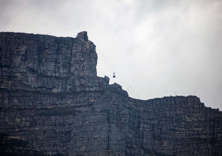 View of Table mountain and the tourist lift in cloudy weather in Cape town. Africa, 스톡 콘텐츠 - 154084155