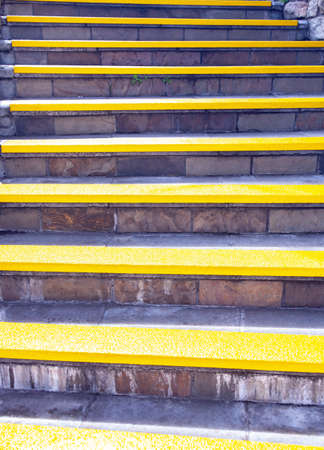 Sunny yellow staircase. Background of a stone staircase with yellow steps. 스톡 콘텐츠 - 153787667
