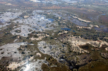 View of the landscape in the Okovango Delta from an airplane with wildlife trails. A moist and swampy plain in the floodwaters of a river in a hot country.