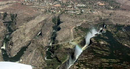 A fault in the earth's crust along the course of the Zambezi River at Victoria Falls. Victoria Falls and the Zamezi Bridge on the border of Zimbabwe and Zambia from the plane.