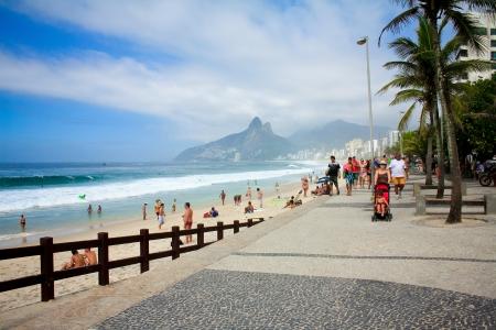 seafronts: RIO DE JANEIRO - JANUARY 2013 - People walk on  Ipanema beach along seafront