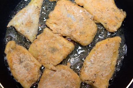 Fish on frying pan  photo