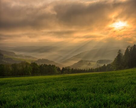 vintage countryside epic spring sunrise,fog,hills,fields,dramatic sky