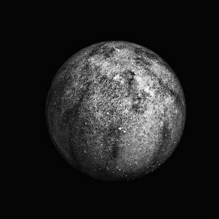 Monochrome dark macro of a black stone ball on black background Stock Photo