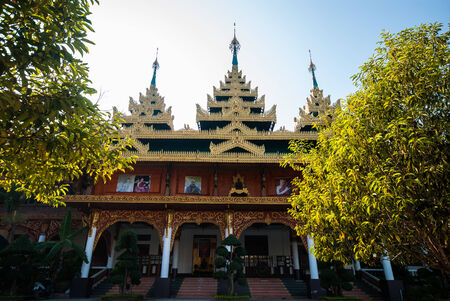 horozontal: One of the impressive buildings of Wang Wiwekaram temple in Sangkhla Buri, lovely surrounded by a green garden.