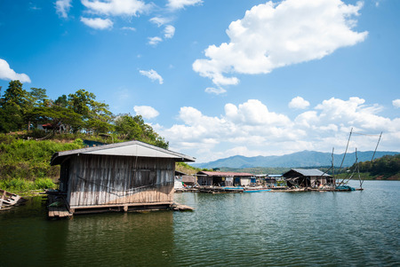 lake dwelling: Wooden house on the river at Thailand
