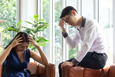 Family problem concept. Young couple talking financial status both depressed and anxious their financial accounting