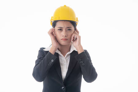 Young engineer woman wear black suit and yellow safety helmet on isolated white background.