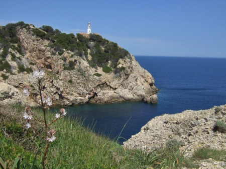 Lighthouse at Cala Rajada - Mallorca - in spring Stock Photo