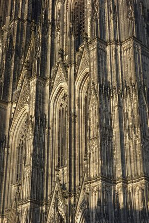 Cologne Cathedral (Cologne, Germany). Detail of West Facade in warm evening sunlight. This cathedral is Germany's most visited landmark and a world heritage site. It is the largest Gothic church in Northern Europe. Construction started in 1248 and was fin Stock Photo
