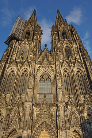 Cologne Cathedral (Cologne, Germany). West Facade in hot evening sunlight.