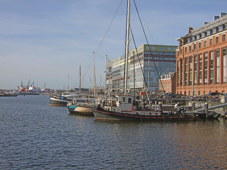 Silodam building and grain silo in Amsterdam port, Netherlands. Silodam, a colorful cubic block containing 157 apartments (privately owned and rental), was built in 2002. It is now a well known landmark of modern Amsterdam.