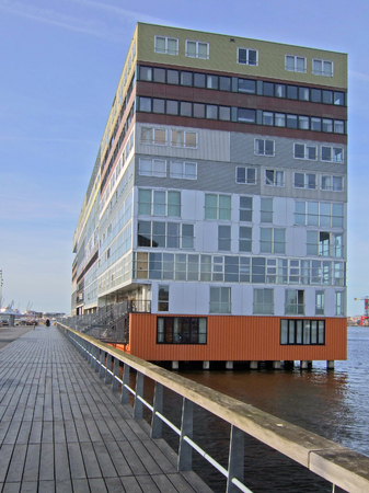 South facade of Silodam, Amsterdam, Netherlands. Silodam, a cubic block containing 157 apartments (privately owned and rental), was built in 2002 and named after nearby grain silos. It is now a well known landmark of modern Amsterdam.