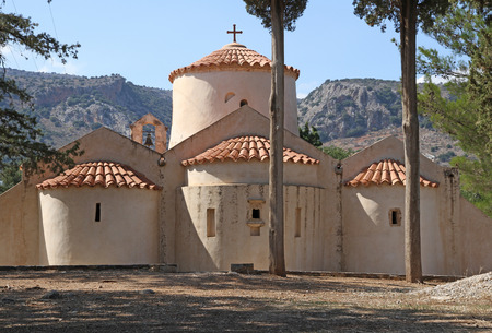 Back view of the old Byzantine Church of Panagia Kera, near the village of Kritsa on the Greek island of Crete. Being one of the most important churches of Crete, it is dedicated to the Assumption of the Virgin. It is supposed to be built in the 13th or 1 Stock Photo