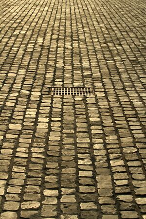 Cobble-paved ground and gully in evening sun