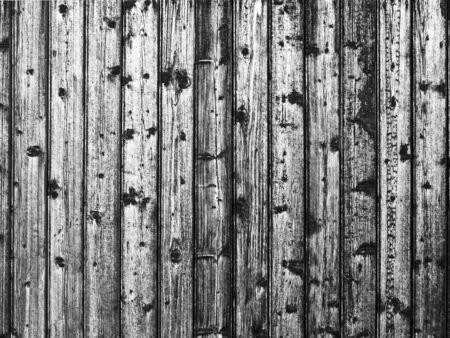 Black and white closeup of rough wooden slats with well visible cell structure