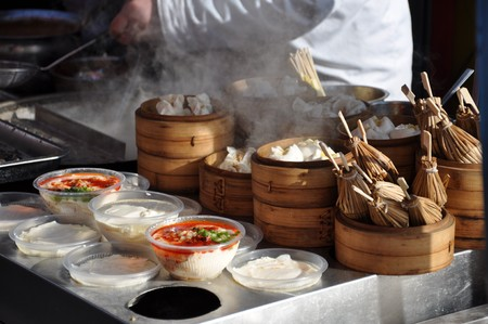 Dumplings and other food at the Food Market in Beijing in China photo