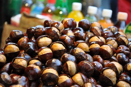 Roasted Chestnut for sale on food market in Beijing in China photo