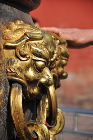 Golden Lion figure on an Urn in the Forbidden City in Beijing, China