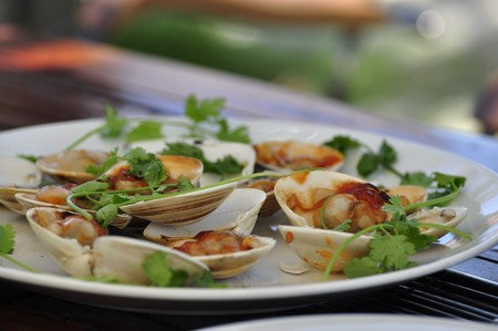 A plate of delicious clams served at the beach in Hoi An, Vietnam