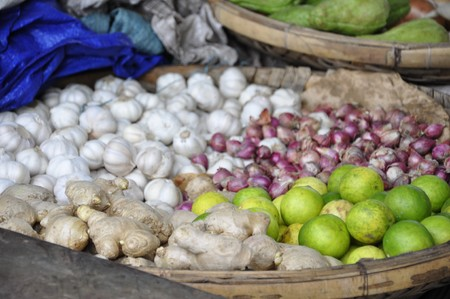 Ginger, garlic, mango and onions for sale on the Nha Trang market in Vietnam Stock Photo