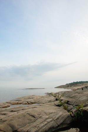 karlstad: Lake viewed from the rocky coastline close to Karlstad, Sweden Stock Photo