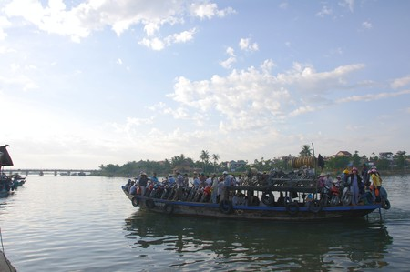 Hoi An river morning ferry filled to its limit on July 12, 2010 in Hoi An, Vietnam.