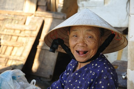 Unidentified woman gives a great black theethed smile on July 12, 2010 in Hoi An, Vietnam.